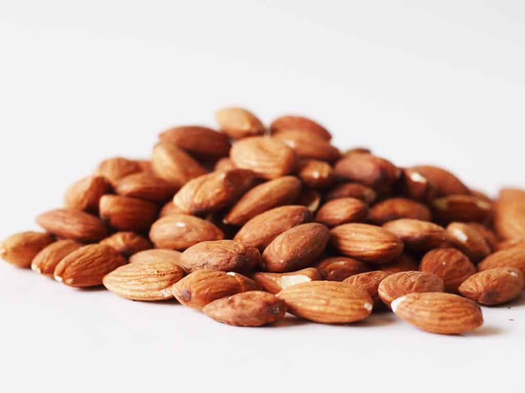 a pile of almonds on a table before being prepared for babies starting solid food