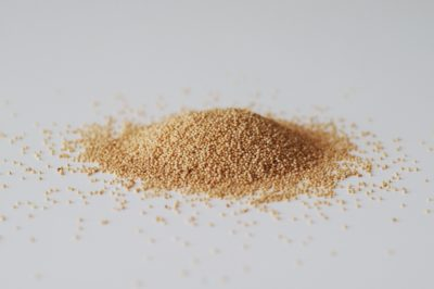 amaranth seeds on a white table before being prepared for babies starting solid food