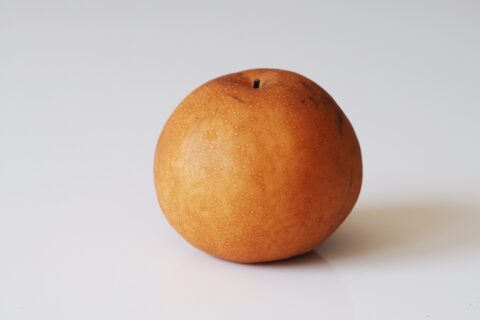a whole Asian pear before being prepared for babies starting solids