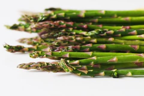 a bunch of green asparagus spears before being prepared for babies starting solid food