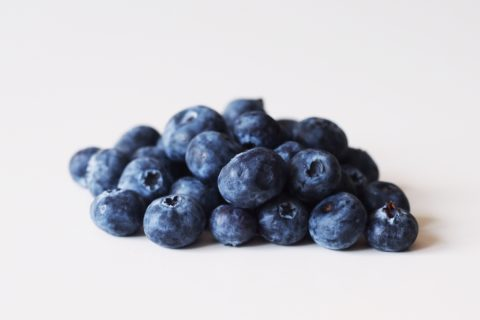 a pile of blueberries before being prepared for babies starting solid food