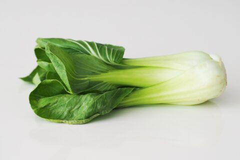 fresh bok choy on a table before being prepared for babies starting solid food