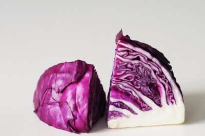 a red cabbage cut in half on a table before being prepared for babies starting solid food