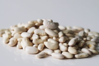 a pile of cannellini beans on a table before being prepared for babies starting solids