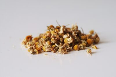 a pile of dried chamomile flowers before being prepared for babies starting solids