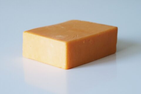 a block of cheddar cheese before being prepared for babies starting solids