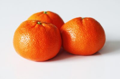 Three whole clementines before being prepared for babies starting solids