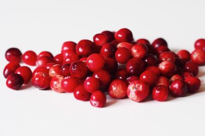 a pile of fresh cranberries before being prepared for a baby starting solids