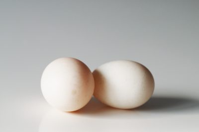 two duck eggs on a table before being prepared for babies starting solid food
