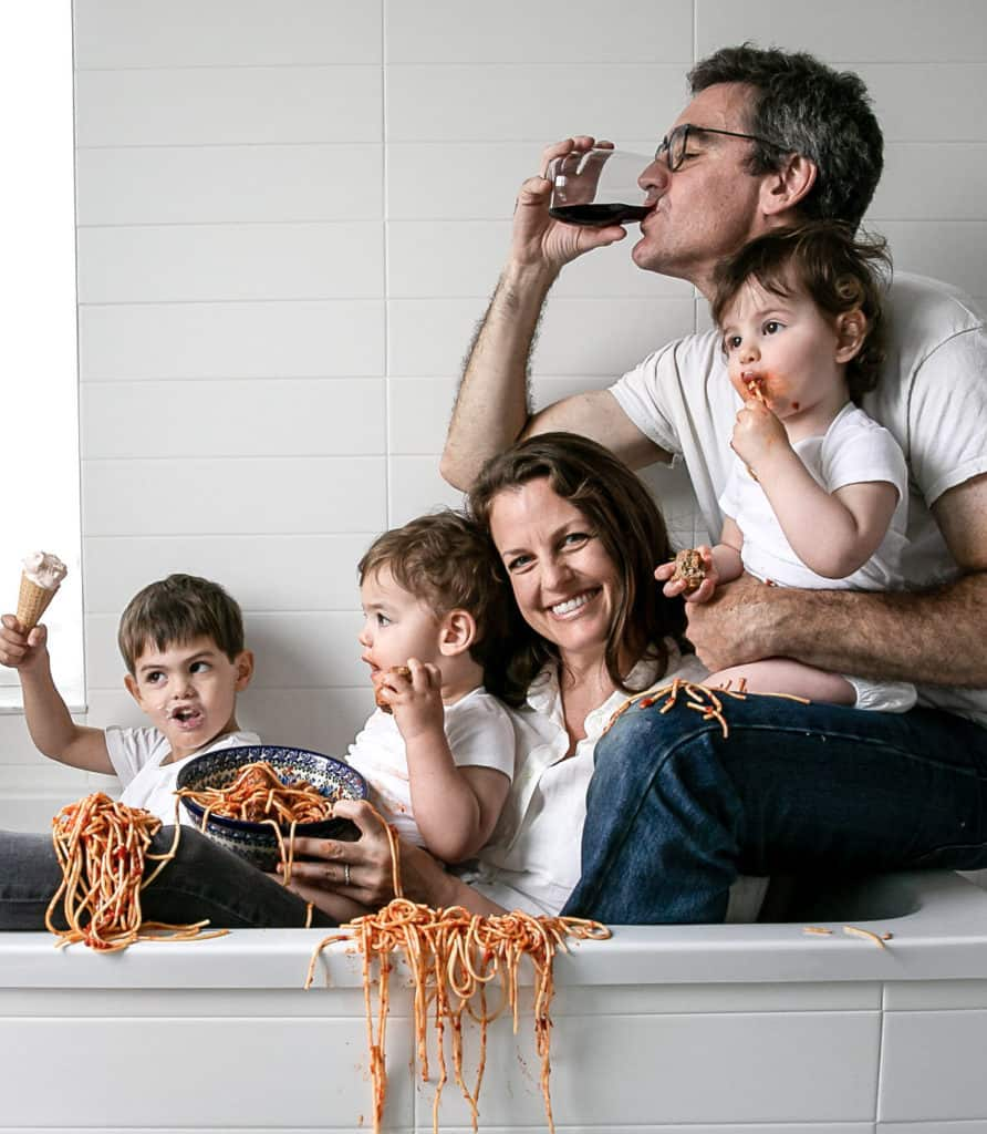 Solid Starts founder Jenny Best with her family in a bathtub eating spaghetti
