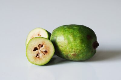 a fejoa fruit cut open on a table before being served to babies starting solids