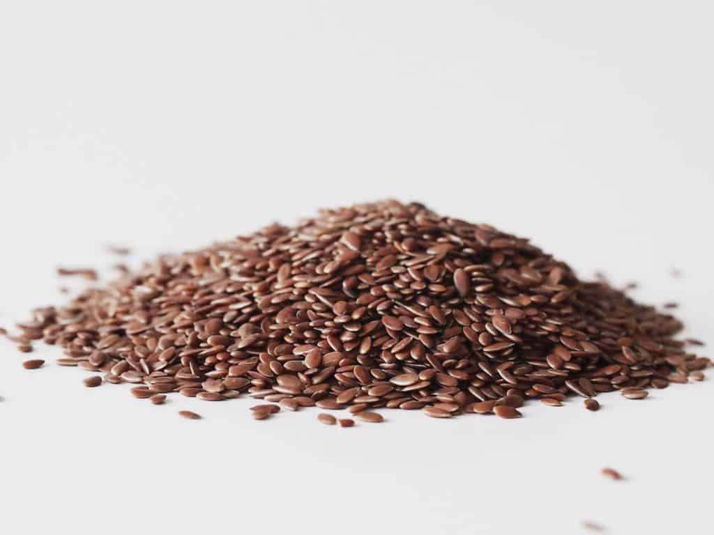 a pile of flaxseeds before being prepared for babies starting solid food