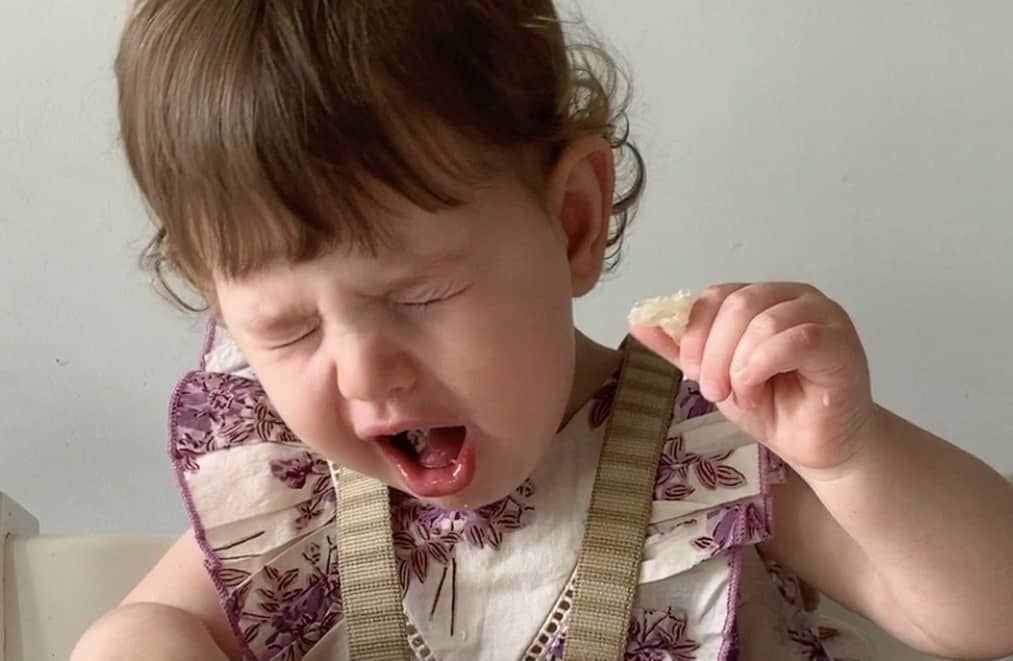 a baby gags on a food when starting solids