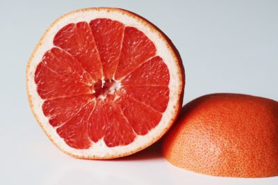 a grapefruit cut in half before being prepared for babies starting solid food