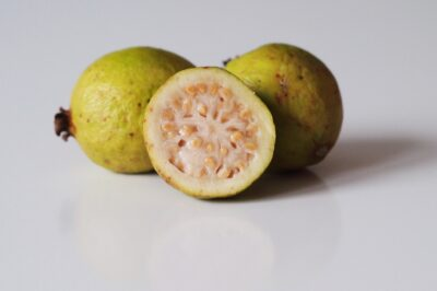A yellow guava cut open before being prepared for babies starting solid food