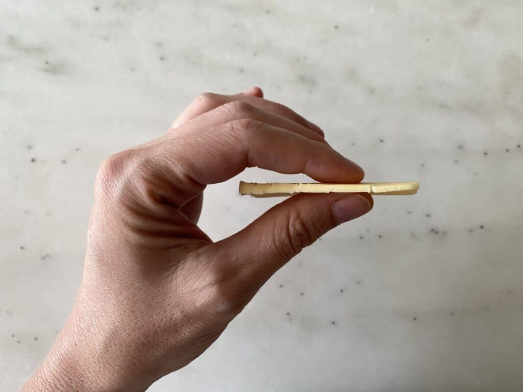 Ruler thin slice of Havarti cheese for babies