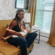 Mother Chrissy Rodriguez breast feeds her baby
