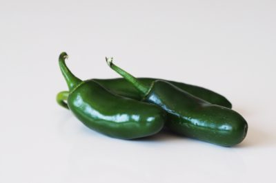 Three jalapeño peppers before being prepared for babies starting solid food