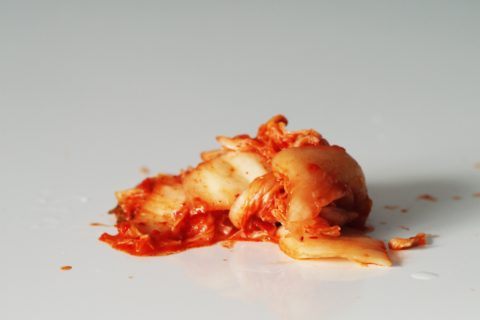 a pile of kimchi on a table before being prepared for babies starting solid food