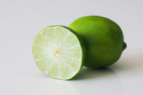 a lime cut in half on a table before being prepared for babies starting solid food