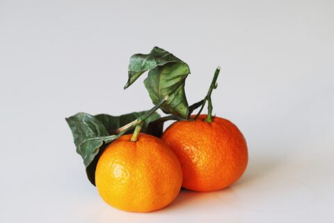 two mandarin oranges before being prepared for babies starting solids