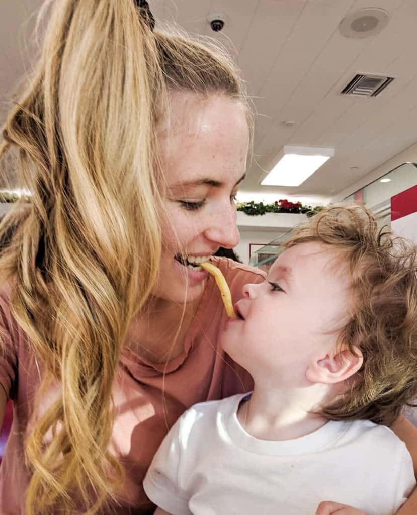 Natalie Archer feeds her son a French fry from her mouth