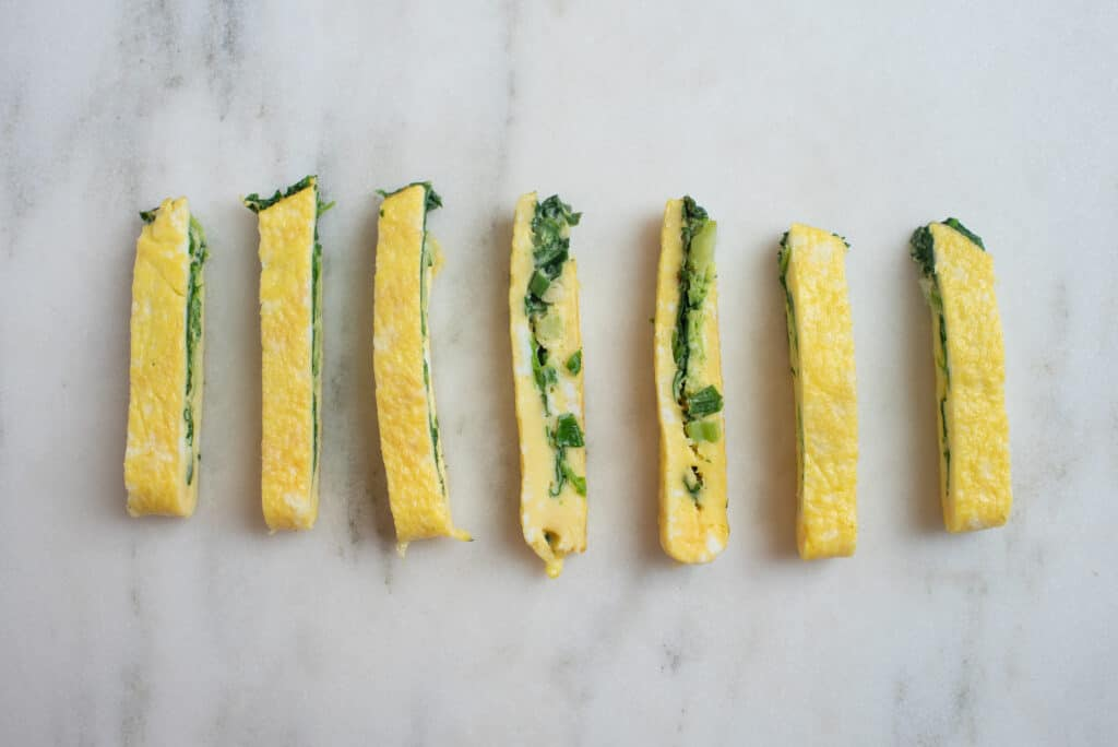 a row of omelet fingers - omelet cut in strips for babies starting solids