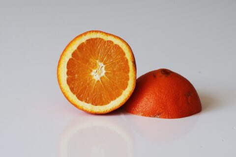 A naval orange cut in half before being prepared for babies starting solids