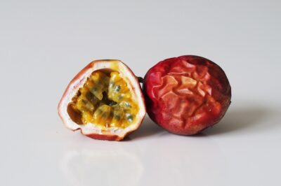 a ripe passion fruit cut halfway open before being prepared for babies starting solids