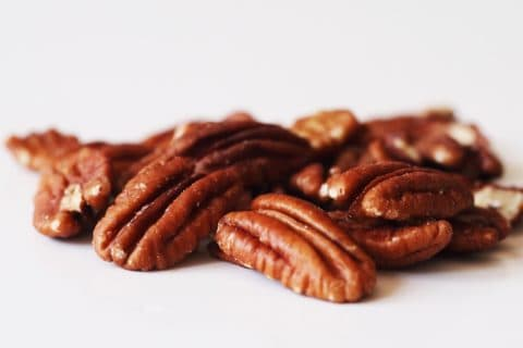 a pile of pecans before being prepared for babies starting solid food