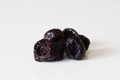 a pile of prunes before being prepared for babies starting solids