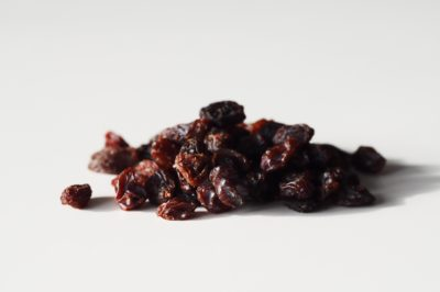 a pile of purple raisins on a table before being prepared for babies starting solid food
