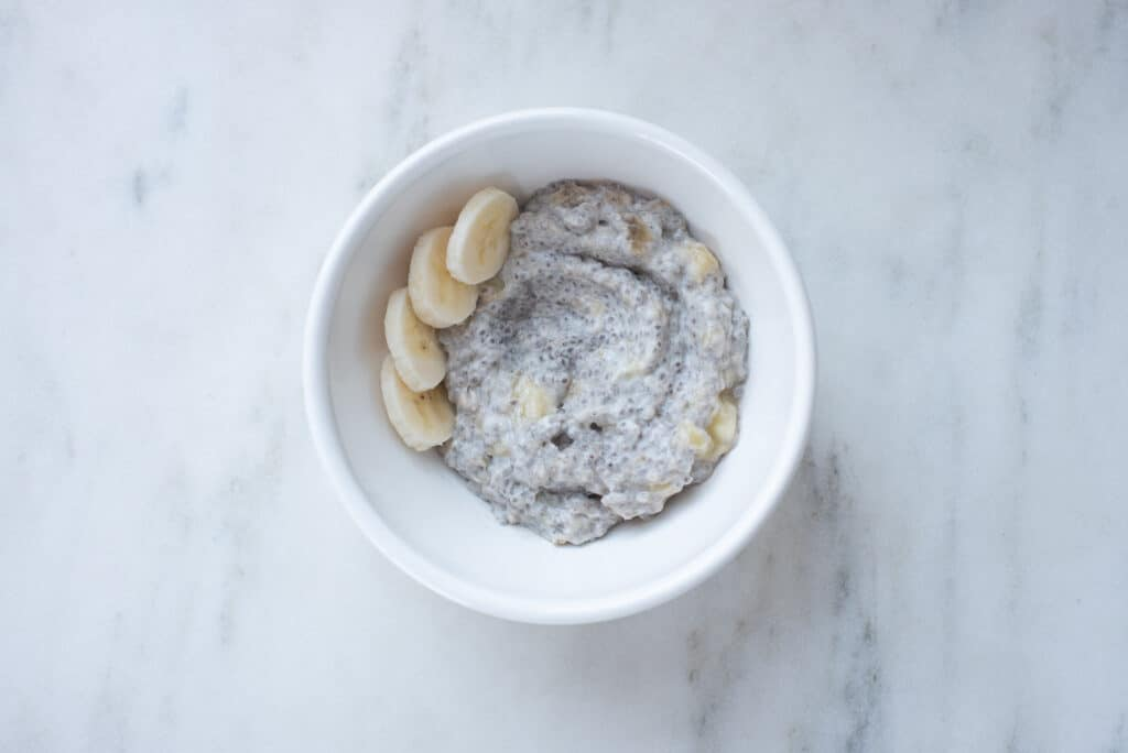 bowl of chia pudding topped with sliced bananas
