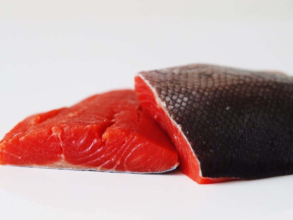 Fresh sockeye salmon on a table before being prepared for babies starting solids