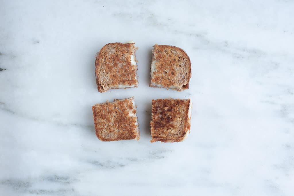 Havarti grilled cheese sandwich, cut into quarters, on a countertop