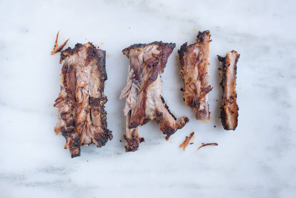 cooked spare ribs on a white background for babies starting solids