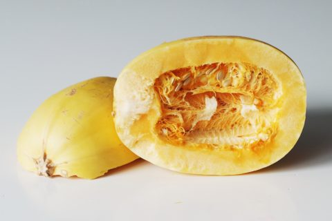 A spaghetti squash cut open before it is prepared for babies starting solids