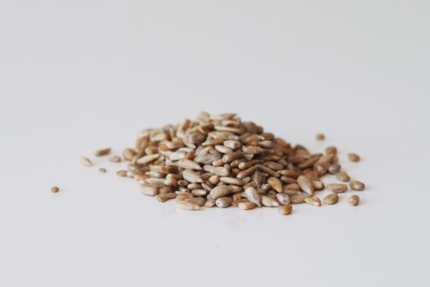 a pile of hulled sunflower seeds before being prepared for babies starting solids