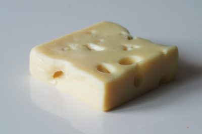 a block of Swiss cheese that will be cut for babies starting solids with baby-led weaning