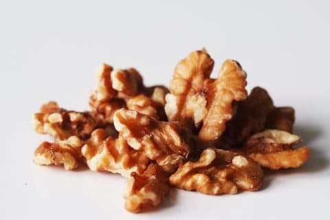 a pile of walnuts on a table before being prepared for babies starting solids