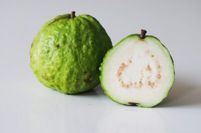 A white guava from thailand cut in half before being prepared for babies starting solids