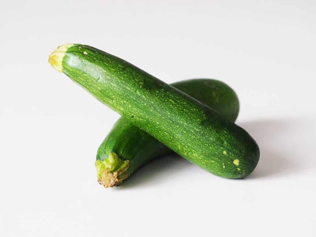 two raw zucchini before being prepared for babies starting solid food