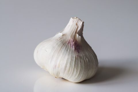 a bulb of garlic on a table before being prepared for babies starting solids