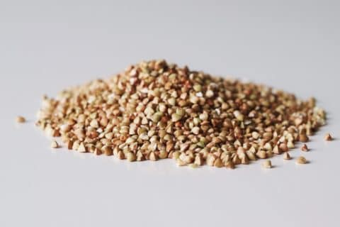 A pile of buckwheat before it has been prepared for a baby starting solid foods