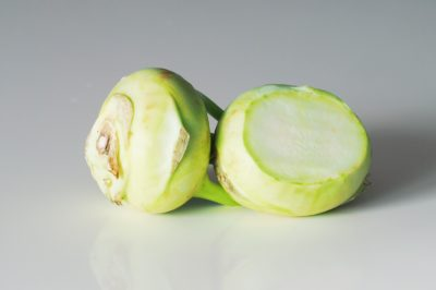 two kohlrabi bulbs, cut open, on a table before being prepared for babies starting solid food