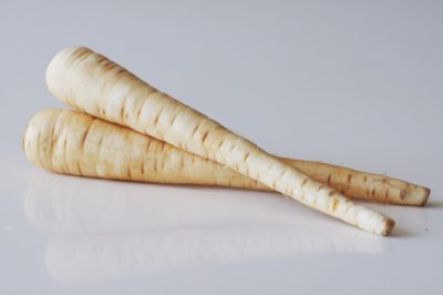 two parsnips on a table before being prepared for babies starting solid food
