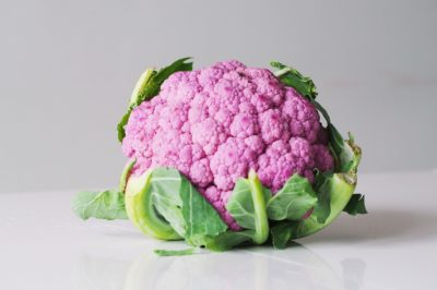 a head of purple cauliflower before being prepared for babies starting solid food