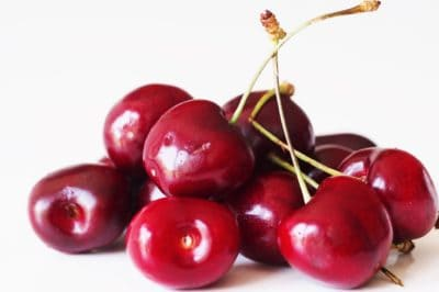 A pile of cherries before they have been prepared for a baby starting solid foods